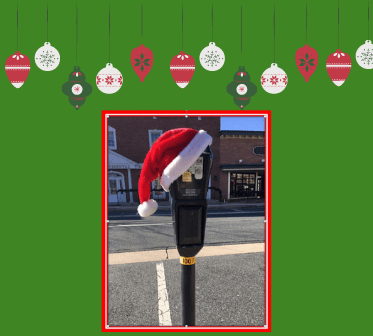Parking meter with Santa hat
